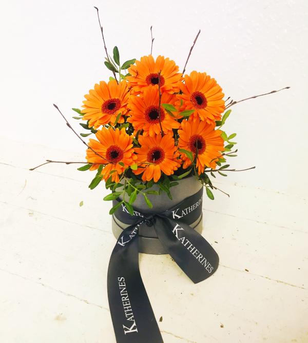 Autumnal Orange Germini Flowers Hatbox