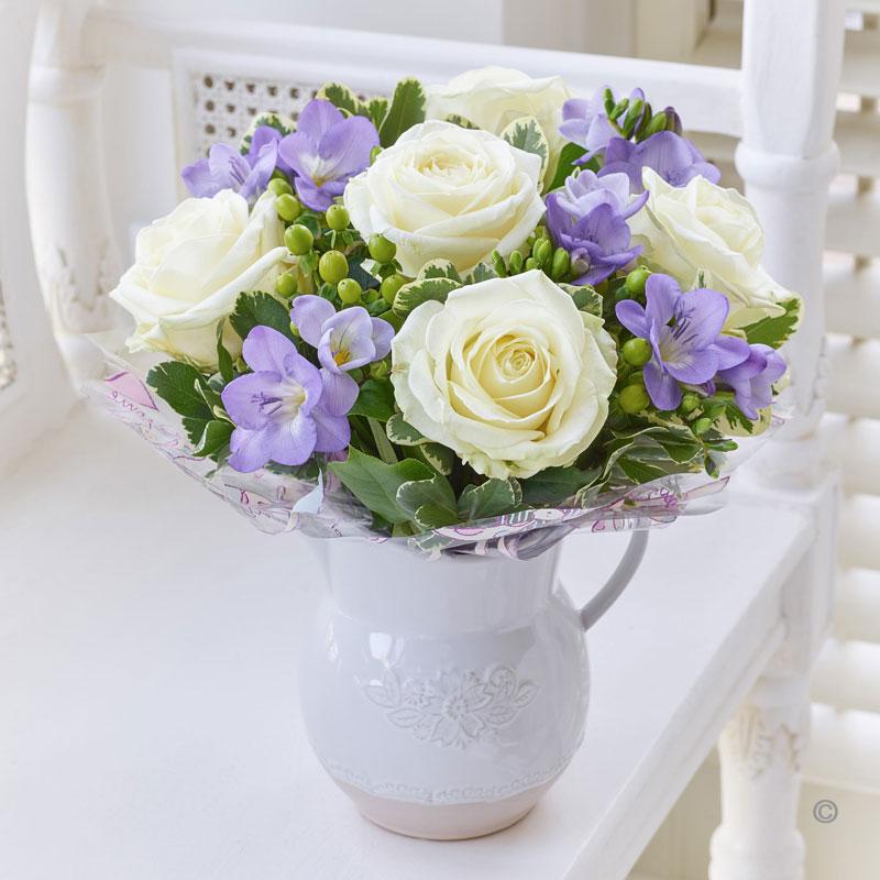 fragrant white rose and freesia jug katherine s florists